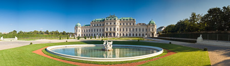 Belvedere palace (1722) and ornate fountain, early evening in Vienna.