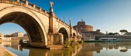 Stunning Ponte SantAngelo bridge crossing the river Tiber and Castel SantAngelo (AD 135), in the heart of Rome. photo