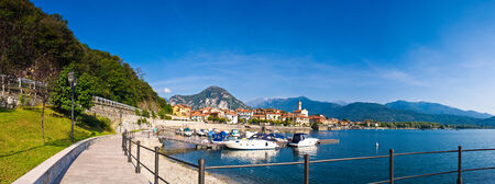 maggiore: Pretty harbor town on Lake Maggiore with traditional villas and leisure boats.