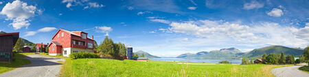 Idyllic rural scene with lakes, mountains and big sky vista, Norway. Imagens
