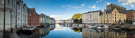 alesund: Coastal reflections of the pretty fishing town of Alesund in Norway. Stock Photo