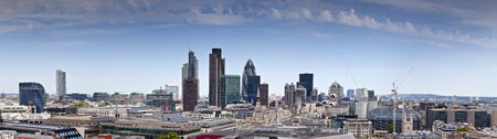 Clear blue sky panoramic of the iconic and varied skyscrapers in the financial district of London photo