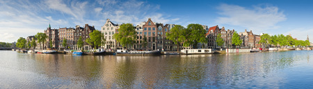 Pretty dutch doll houses reflected in the tranquil canals of Amsterdam.
