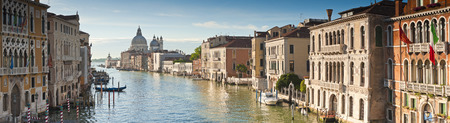 italian landscape: View of the Grand Canal and the stunning baroque Santa Maria Della Salute (1687) church in Venice and colourful villas bathed in early morning light Stock Photo