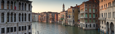 venetian: Traditional 16th century villas, blue skies along the Grand Canal in Venice. Stitched panoramic image.
