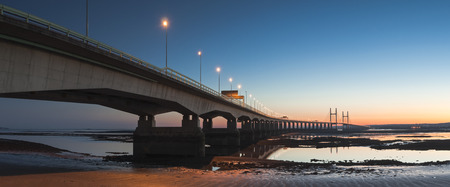 severn: Golden sunset over the Second Severn Bridge providing a vital link for England and Wales.