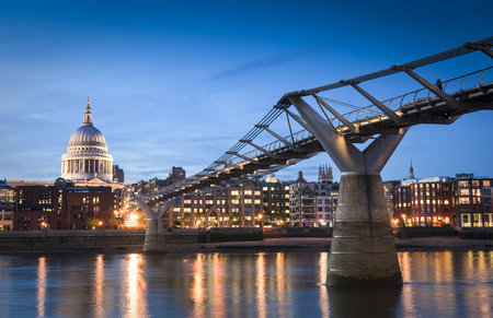 millennium bridge: Pretty night time illuminations of St Pauls Cathedral and the millennium bridge along the river Thames.