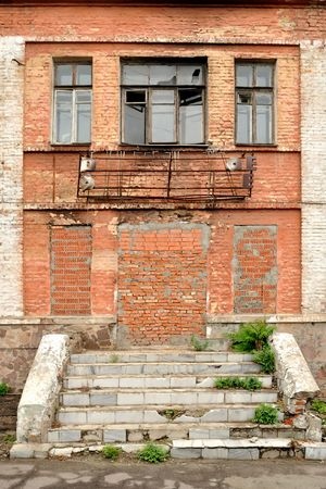 dilapidated: The old dilapidated building of red bricks