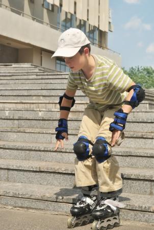 susceptibility: The boy practices to skate at the roller blades Stock Photo