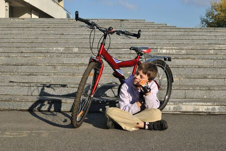 susceptibility: The boy and red bicycle