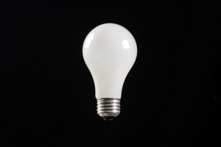 incandescent light buld with a black background photo