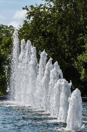 ejaculation: line of water spouts in a pond Stock Photo