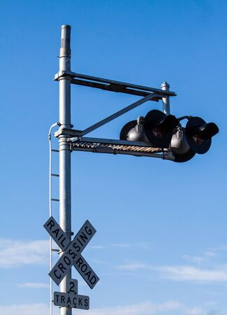 rustic railway crossing sign close up Stock Photo