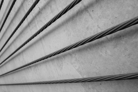 heavy industry: steel cable, concrete support cable Stock Photo