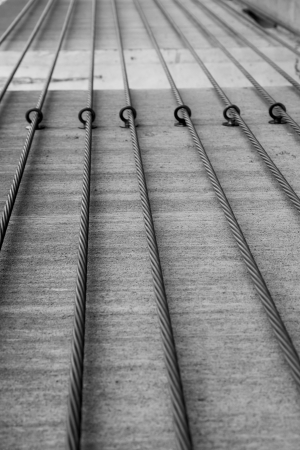 steel support cables for concrete in black and white photo