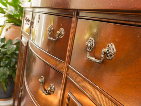 drawers: vintage antique furniture hardware in afternoon natural light Stock Photo