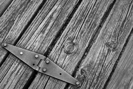 hinge: Old rusted hinge holding floating wooden dock together