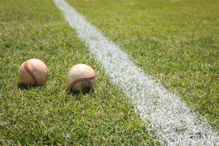 outfield: Baseball on a little league baseball field in spring Stock Photo