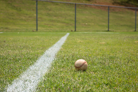 little league: Baseball on a little league baseball field in spring Stock Photo