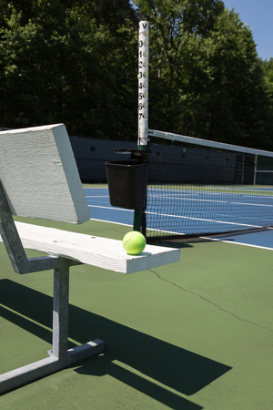bounds: Tennis court sideline on a sunny day
