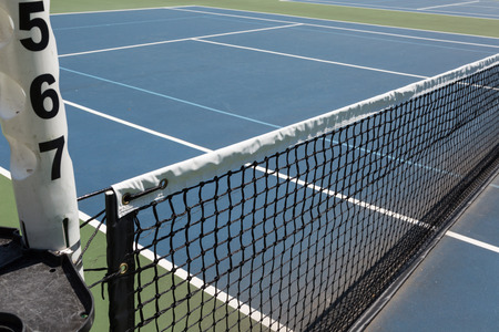 sideline: Tennis court sideline on a sunny day