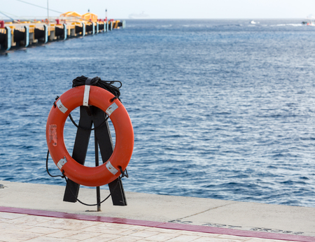 safe water: personal life ring on the dock seaside Stock Photo