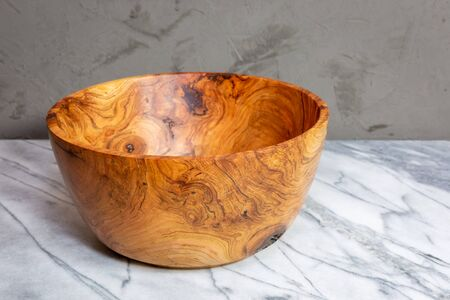 Cherry wood bowl with figured grain next to a burl
