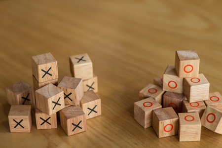 rival: Two different groups of bricks that rival each other and are in competition in separate teams.  These small mounts of blocks are perfect to build something altogether new with room for copyspace. Stock Photo