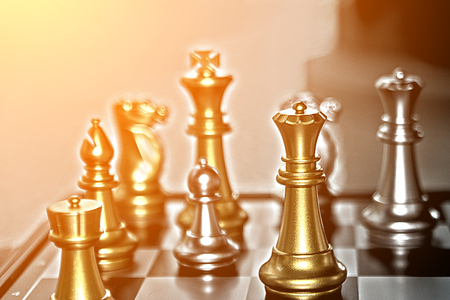 Competition in business, chess pieces and bright concept photo with a variety of players but only one winner.  Copy space.