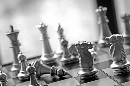 metalic: Lucky chess game business strategy concept.  Black and white game with copy space.  Strategize and plan your road to victory. Stock Photo