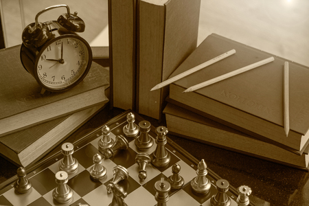 chess board: Competition in business concept with brown and yellow style old time look.  Retro concept with creativity and copy space.  Intelligence and wit.
