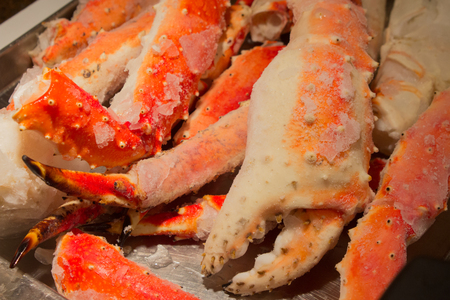 Frozen king crab legs with giant claw and succulent dinner ready to be broiled, boiled, or grilled. Stock Photo