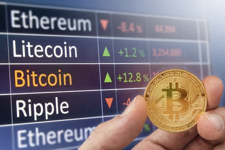 Bitcoin exchange financial chart with man holding bitcoin.  Crypto exchange ticker and rise fall chart. Stock Photo
