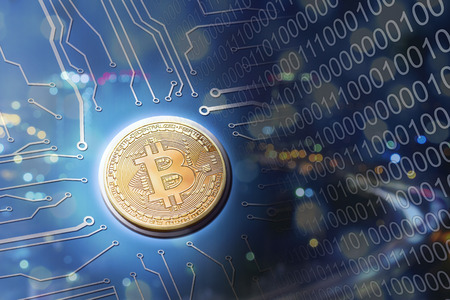 Bitcoin circuit board electronic currency concept in blue with city. Stock Photo