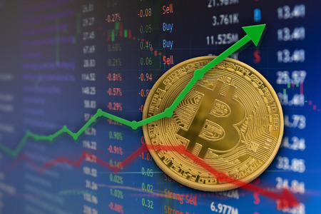 Bitcoin rising and falling in financial business market concept with charts.
