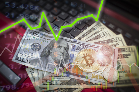 Online bitcoin trading and financial upswing with big gains on laptop internet keyboard business concept.