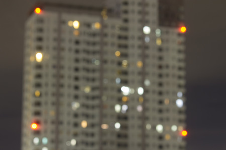 Bokeh for apartment windows at night.  Highrise housing and living in the urban city core.