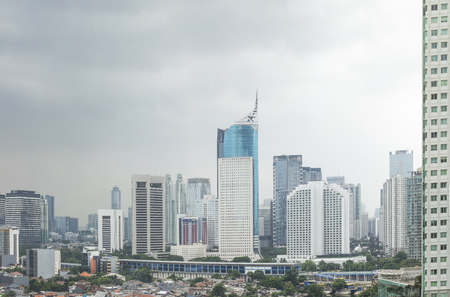 Jakarta city skyline.  Indonesian travel and sightsee in urban central city with highrise buildings and bright light. Stock Photo