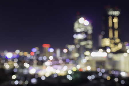 Club district with many vanues for night life.  Blurred bokeh city shot at night.  Party and lifestyle night on the town.