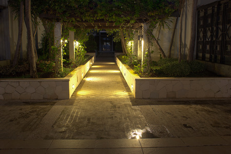 Romantic path at night with mood lighting in luxurious fancy district for dining and night life. Stock Photo