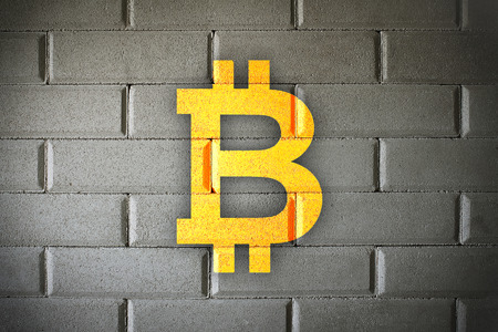 Bitcoin blockchain solid wall security and studry security with white brick background.  Bright color bitboin logo. Stock Photo