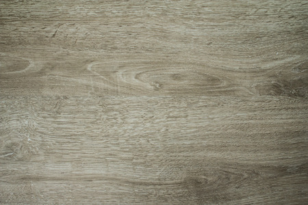 Wooden flooring board texture at an angle for carpenter and grunge cracks concept.  Vintage dirty old boards.