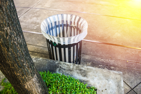 Blurred background and people.  Trash can in evening for waste bin throwing away garbage concept. Stok Fotoğraf - 100100252