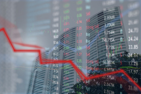 Spiraling down trend loss of investor money in stock market as investors bail out of company stock.  Big business with skyscrapers and major financial crisis.