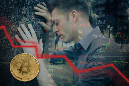 Bitcoin price drop and investors lose millions of dollars.  Falling price red lines and candles.  Failure. Stock Photo