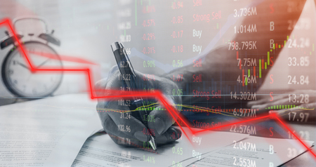 Price drop and failure while signing paper to give ownership to the bank.  Investment loss and angry man signs off on bad news. Stock Photo