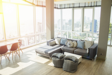 Luxurious penthouse real estate with modern trendy design and view of the ocean and city.