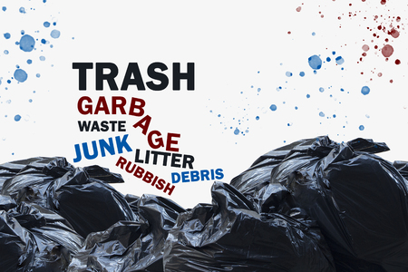 Trash concept with stacked garbage bags and waste.  Other words are junk and litter, rubbish and waste.  Splattered red and blue dirt. Stock Photo