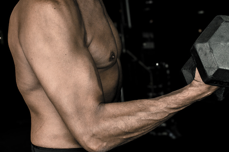 Bicep curl form for bulking and weight training for large arms by doing dumbbell reps.