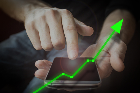 Mobile device upswing of financial investmetn bullish market.